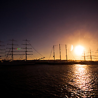 The sun sets at Wellington Dock behind a fleet of Tall Ships.  The Christian Radich, Cuauhtemoc, Captain Miranda and Roal Amudsen can be seen here.