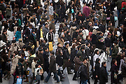 crowd of people cross at the Hachiko zebra crossing in Shibuya