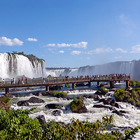 Brazil. The awe inspiring Iguazu Falls - one of the seven wonders of the natural world roar forcefully. <br /> For a scenic highlight, it's hard to top the Iguazu Falls, the largest in the world in terms of water volume, with an amazing 275 distinct falls that plunge from varying heights spread over a 3km semi-circle.