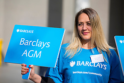 © licensed to London News Pictures. London, UK 24/04/2014. A steward directs Barclays share holders to Barclays Annual General Meeting (AGM) outside Royal Festival Hall in London. Photo credit: Tolga Akmen/LNP