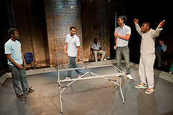 "© Copyright licensed to London News Pictures. 12/11/2010. ""Inside"" by Philip Osment, presented by Playing Out at the Roundhouse, Camden, London. Based on the real experiences of young fathers in prison, the play deals with big questions surrounding relationships, both with their own fathers and with their children. L to R: Michael Amaning, Darren Douglas, Kyle Thorne, Ayo Bodunrin."