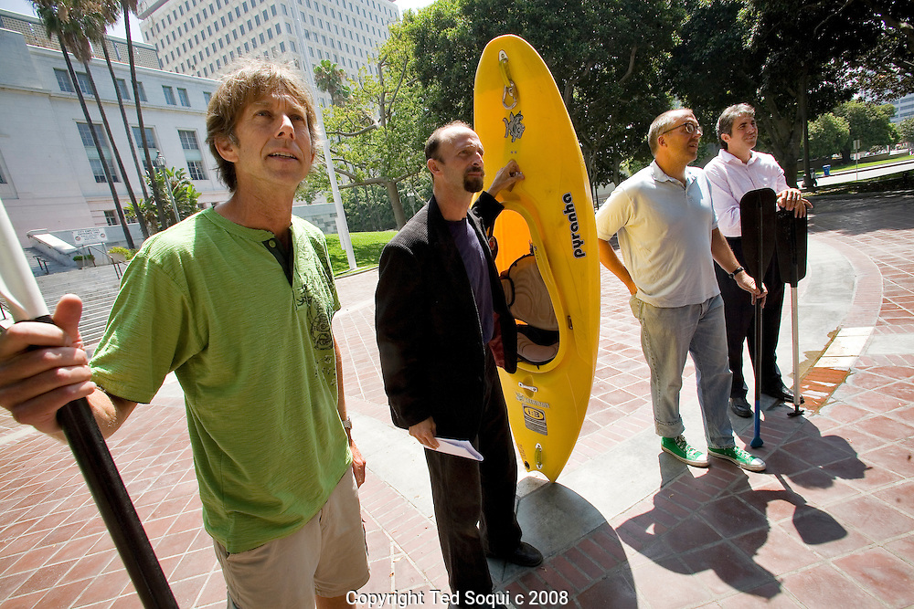 Members of the LA River Expedition kayak team hold a press conference in front of LA City Hall before they take to the river on Friday July 25. The 52 mile trip down the LA River should take 2 days to complete..The objectives of the expedition are to raise consciousness about the river's revitalization efforts, to raise money in support of river-related environmental organizations, to study ways to make access to the river as healthy and safe as possible, and to raise the bar for clean water and grand urban visions that will empower and protect local and national waterways for ourselves and for future generations.
