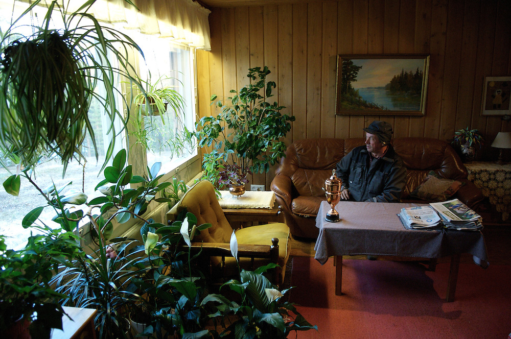 Lemmonjokki, FINLAND.  October 23, 2007. With a trophy he won in 1977 for champion lasso thrower, Veggai, 58, looks out onto his lake.  In addition to working as a Sami Herdsman he also has a penchant for gardening. ..