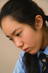 Secondary school student concentrating in an art lesson,