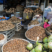 Ginger, coconuts, and other edible roots for sale at Cho Dong Ba, the main city market in Hue, Vietnam.