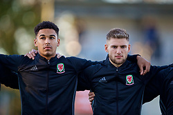 BANGOR, WALES - Saturday, November 17, 2018: Wales' Ben Cabango (L) and Brandon Cooper stand for the national anthem before the UEFA Under-19 Championship 2019 Qualifying Group 4 match between Sweden and Wales at the Nantporth Stadium. (Pic by Paul Greenwood/Propaganda)