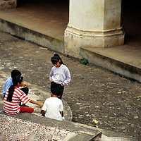 Central America, Guatemala, Antigua. Children pass time among the ruins in Antigua, Guatemala.