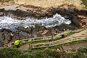 Waves from the Pacific Ocean crash into the Devils Churn, at Cape Perpetua Scenic Area, Siuslaw National Forest, Yachats, Oregon coast, USA.