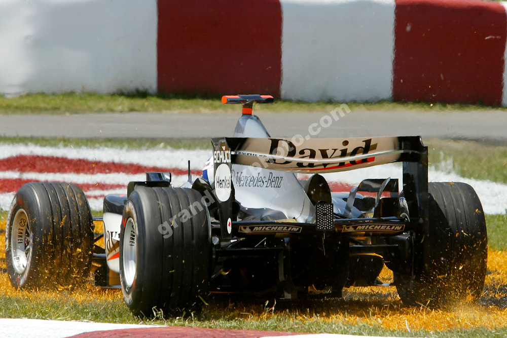 David Coulthard (McLaren-Mercedes) on the grass in the first corner of the 2004 Canadian Grand Prix at the Circuit Villeneuve in Montreal. Photo: Grand Prix Photo
