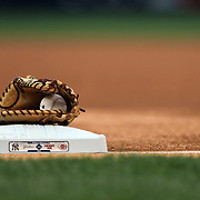 Mark Teixeira, New York Yankees, mitt at first base during the National Anthem before the New York Yankees Vs Cincinnati Reds baseball game at Yankee Stadium, The Bronx, New York. 18th July 2014. Photo Tim Clayton