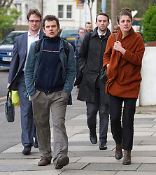 © London News Pictures. 23/04/2012. Feltham, UK. Trenton Oldfield (second from right) arriving at Feltham Magistrates' Court in West London, with a group of unidentified people, where he is charged under the Public Order Act after he allegedly swam out into the Thames during the The boat race between Oxford and Cambridge. The incident forced the boats to stop and re-start from the halfway point. Photo credit : Ben Cawthra /LNP