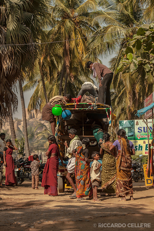 A vehicle is loaded up for a journey in Hampi, India