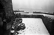 13/01/1963<br /> 01/13/1963<br /> 13 January 1963<br /> Snow scenes from Kiliney and Dun Laoghaire, Co. Dublin. View of Martello tower from pier, with lobster cages.