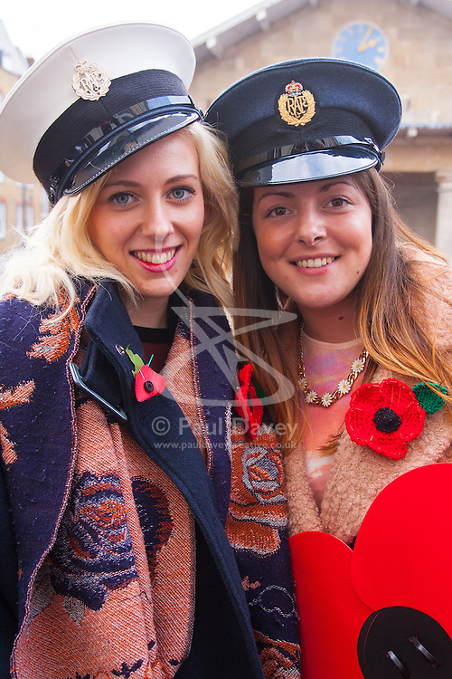 Covent Garden, London, October 30th 2014. They Royal British Legion's Poppy Day in London centred around Covent Garden where bands, choirs, classical and pop musicians entertained crowds as Air Force personnel carrying donation buckets sold poppies, hoping to raise in excess of £1 million. Pictured: Emma Nettleingham, left and Claire Harley of Billericay in Essex commandeer  two Air Force officers' hats.