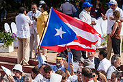 "10 JANUARY 2007 - MANAGUA, NICARAGUA: Members of the Cuban delegation wave their flag at the inauguration of Daniel Ortega in Managua, Nicaragua. Ortega, the leader of the Sandanista Front, was sworn in as the President of Nicaragua Wednesday. Ortega and the Sandanistas ruled Nicaragua from their victory of ""Tacho"" Somoza in 1979 until their defeat by Violetta Chamorro in the 1990 election.  Photo by Jack Kurtz"