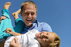 Father and son having fun, smiling, Bavaria, Germany