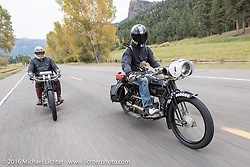 Mechanic and restorer Tanner Whitton of New York rides Mark Hill's 4-cylinder 1915 class-2 Henderson alongside Vern Acres of Ontario, Canada on his 4-cylinder 1914 Henderson class-2 motorcycle down the west side of Wolf Creek Pass during the Motorcycle Cannonball Race of the Century. Stage-10 ride from Pueblo, CO to Durango, CO. USA. Tuesday September 20, 2016. Photography ©2016 Michael Lichter.