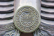 Detail of a ceramic roof tile inside the Imperial City in Hue, Vietnam.