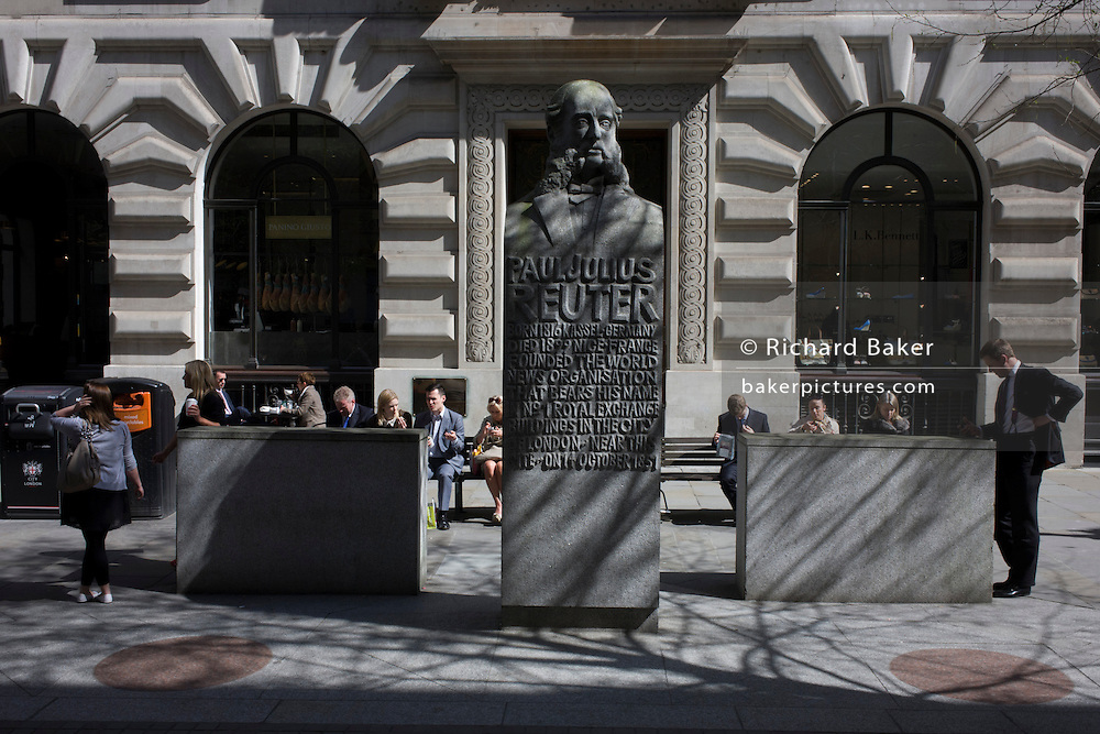 A stone carving of the German-born news tycoon, Paul Julius Reuter, seen at lunchtime in the City of London, the capital's financial district.