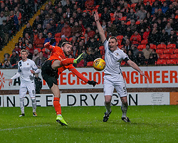 Dundee United's Paul McMullan and Alloa Athletic's Andy Graham. Dundee United 2 v 1 Alloa Athletic, Scottish Championship game played 7/12/2019 at Dundee United's stadium Tannadice Park.
