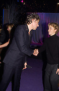 Sir Bob Geldof with the star of the film Jeremy Sumpter, party after the Peter Pan film world premiere in aid of the Great Ormond St. Embankment park. 9 December 2003. hospital.© Copyright Photograph by Dafydd Jones 66 Stockwell Park Rd. London SW9 0DA Tel 020 7733 0108 www.dafjones.com