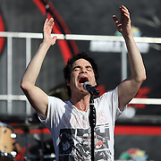 Pat Monahan of the Grammy award winning band Train sings during a one hour performance prior to the start of the NASCAR Coke Zero 400 race at Daytona International Speedway in Daytona Beach, Fl., on Saturday July 7, 2012. (AP Photo/Alex Menendez)