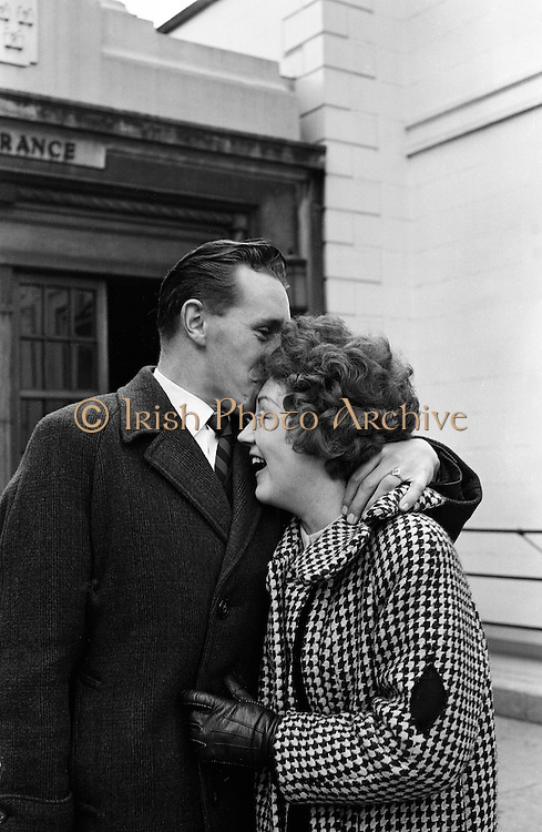 Bus conductor Liam Alfred and his wife of 8 months, Mary, were one of the lucky couples to get a house . (Note the diamond patch on Mary's coat sleeve. It was commonplace at the time for family members to wear a black patch at the time of a bereavement.).06.04.1962