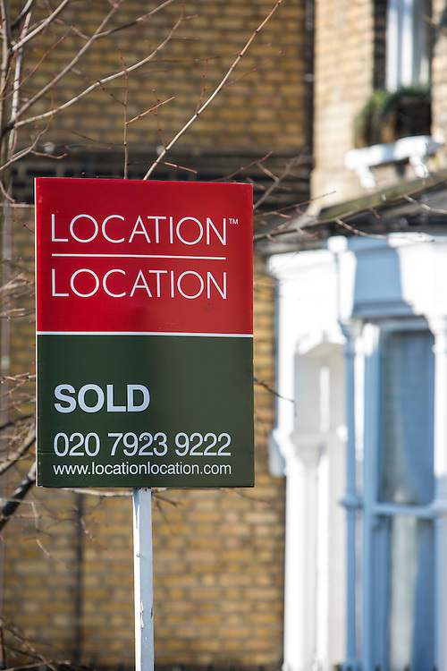 Location, Location. A property Sold sign outside a property on Cazenove Road, London.