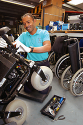 Wheelchair Services Manager services an NHS wheelchair in workshop Yorkshire UK