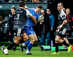 Hallam Amos of Dragons under pressure from Tom Botha of Ospreys<br /> <br /> Photographer Simon King/Replay Images<br /> <br /> Guinness PRO14 Round 18 - Ospreys v Dragons - Saturday 23rd March 2019 - Liberty Stadium - Swansea<br /> <br /> World Copyright © Replay Images . All rights reserved. info@replayimages.co.uk - http://replayimages.co.uk