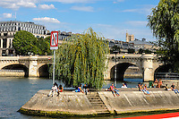 Paris, France. View from a boat on the river Seine. Saint-Jacques Towerr in the background. Ile de la Cite and Pont Neuf.