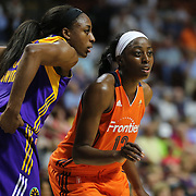 UNCASVILLE, CONNECTICUT- MAY 26:  Sister Nneka Ogwumike #30 of the Los Angeles Sparks and Chiney Ogwumike #13 of the Connecticut Sun during the Los Angeles Sparks Vs Connecticut Sun, WNBA regular season game at Mohegan Sun Arena on May 26, 2016 in Uncasville, Connecticut. (Photo by Tim Clayton/Corbis via Getty Images)