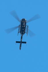 © Licensed to London News Pictures. 18/01/2018. Curridge, UK.  A police helicopter searches over woodland at the scene in Curridge, Berkshire where police are hunting for a wolf that has escaped from its enclosure at the UK Wolf Conservation Trust nearby. Armed police are on the scene. Photo credit: Ben Cawthra/LNP