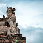 BAGAN, MYANMAR--A restored statue of a dragon on top of an elephant on the roof of Abeyadana Temple. Located just south of Myinkaba Village in the Bagan Archeological Zone, Apeyadana Temple is named after Apeyadana, an 11th century chief queen consort of King Kyansittha of the Pagan Dynasty of Burma (Myanmar) and maternal grandmother of King Sithu I of Pagan. As with most Burmese names, it is transliterated into English in various ways. Other variations include Ape-ya-da-na, Ape-Yadana-Phaya, and Abeyadana. To license and download this image, please click on the shopping cart icon above.