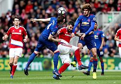 Alvaro Negredo of Middlesbrough battles with Phil Jones and Marouane Fellaini of Manchester United - Mandatory by-line: Robbie Stephenson/JMP - 19/03/2017 - FOOTBALL - Riverside Stadium - Middlesbrough, England - Middlesbrough v Manchester United - Premier League