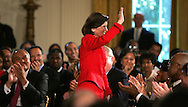 A 24 MG IMAGE OF:..Luci Baines Johnson waves at an White House East Room event to mark the 40th anniversary of the signing of the Civil Rights bill. On the left Thurgood Marshall Jr. (son of Justice Thurgood Marshall and on right Condoleezza Rice. Photo by Dennis Brack