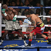 LAS VEGAS, NV - SEPTEMBER 13: Floyd Mayweather Jr. (L) leans back in a neutral corner as Marcos Maidana attacks during their WBC/WBA welterweight title fight at the MGM Grand Garden Arena on September 13, 2014 in Las Vegas, Nevada. (Photo by Alex Menendez/Getty Images) *** Local Caption *** Floyd Mayweather Jr; Marcos Maidana