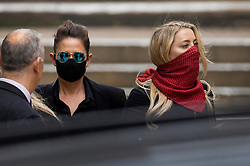 © Licensed to London News Pictures. 07/07/2020. London, UK. US actor Amber Heard (R)  and  Bianca Butti leave The High Court in Central London. Johnny Depp's libel trial against The Sun newspaper is due to take place over the next three weeks over allegations he was violent and abusive towards his ex-wife Amber Heard. Photo credit: Peter Macdiarmid/LNP