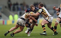 Sale's Mark Jennings is tackled by Wasps' Matt Mullan and Tommy Taylor during the Aviva Premiership match at the AJ Bell Stadium, Sale.