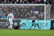 Andre Ayew of West Ham shoots and scores his teams 1st goal. Premier league match, Swansea city v West Ham United at the Liberty Stadium in Swansea, South Wales on Boxing Day, Monday 26th December 2016.<br /> pic by  Andrew Orchard, Andrew Orchard sports photography.