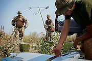 'Master' and his team are setting up signal transmission poles for the unmanned surveillance aircraft (drone) they are about to launch, being used in collaboration with the Ukrainian army and patriotic volunteers' groups, to collect visual information over pro-Russia separatists' positions, in an undisclosed location near the village of Berdyans'ke, 2 km from the frontline town Shyrokine, southeast Ukraine.