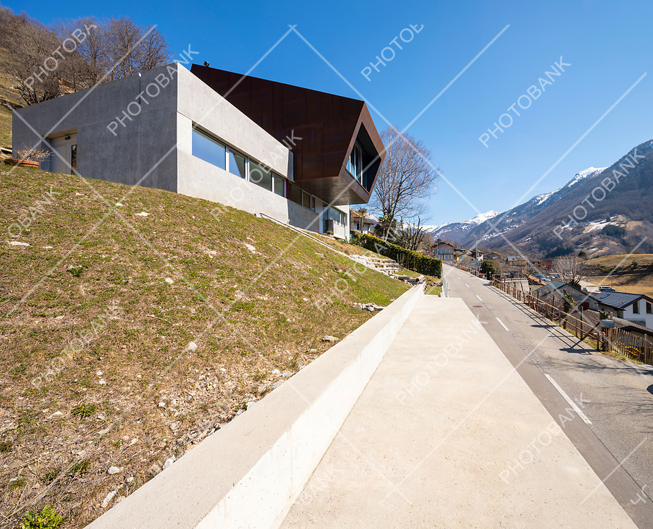 Exterior modern isolated villa, surrounded by nature. Iron and concrete cladding. Nobody inside