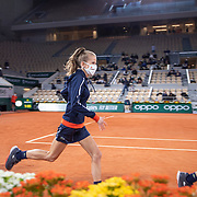 PARIS, FRANCE October 07.  Ball boys and girls leave the court during a staff change over on Court Philippe-Chatrier during the French Open Tennis Tournament at Roland Garros on October 7th 2020 in Paris, France. (Photo by Tim Clayton/Corbis via Getty Images)
