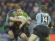 Photo Peter Spurrier<br /> 07/12/2002<br /> European Rugby - Heineken Cup Northamton vs Cardiff.<br /> Saints Chris Hyndman is caught with the ball.