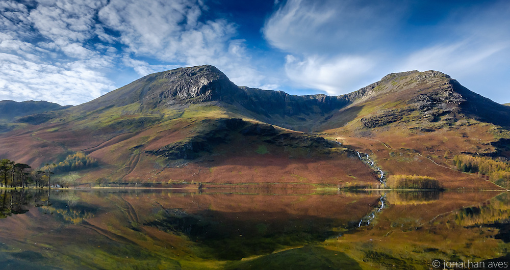 Views of High Stile and High Crag reflected in Buttermere Lake on an October Morning, Lake District, UK