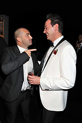 Left to right, LOUIE SPENCE and CRAIG REVEL-HORWOOD at the annual Collars & Coats Gala Ball in aid of Battersea Dogs & Cats Home held at Battersea Evolution, Battersea Park, London on 11th November 2011.