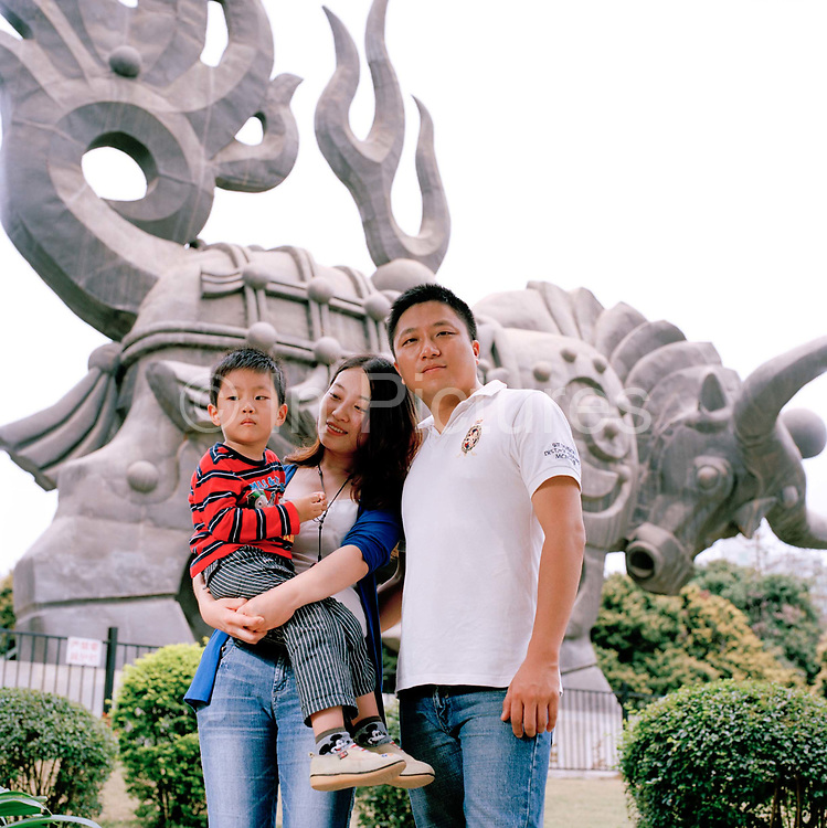 """Shu Tia Chen, 32 an accountant and her husband, Gan Yafei, 33 a project manager for IBN and their son, Gan Muze, 3, They live in  in Shenzhen, Guangdong province. ?People who have more than one child don't care about their jobs. We know people in the West think the one child policy is an abuse of human rights? says Yafei  ?but in developing countries there are more important things to worry about- like putting food on the table.""""..Its over thirty years (1978) since the Mao's Chinese government brought in the One Child Policy in a bid to control the world's biggest, growing population. It has been successful, in controlling growth, but has led to other problems. E.G. a gender in-balance with a projected 30 million to many boys babies; Labour shortages and a lack of care for the elderly. ."""