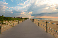 The beach and boardwalk are quiet as early morning arrives in Spring Lake, NJ.