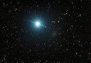 Regulus, the brightest star in constellation Leo and 79 l.y. from Earth, and the neighbouring dwarf galaxy Leo I lying 820 000 l.y. away.