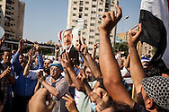 A photograph of former Egyptian president Mohammed Morsi is held during pro-Muslim Brotherhood demonstrations in Nassr City, Cairo.